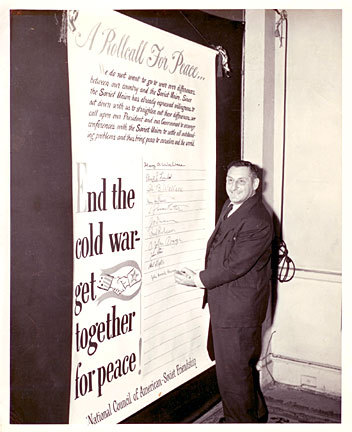 Photograph of John Howard Lawson signing 'A Rollcall for Peace...' for the National Council of American-Soviet Friendship. John Howard Lawson, JoJan, photographer.