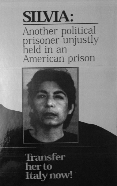 Silvia: another political prisoner unjustly held in an American prison. Transfer her to Italy now! [laminated placard]. Silvia Baraldini.