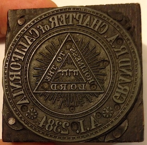 Grand R A Chapter of California / AI 2384 [Organizational seal mounted on wooden block for use in a print shop]. Grand Royal Arch Chapter of California.