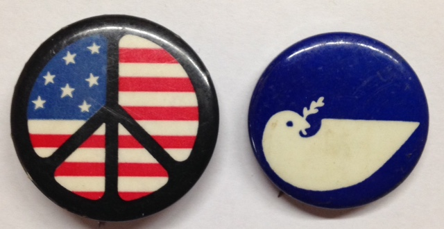 [Pinback button depicting peace sign with American flag background]