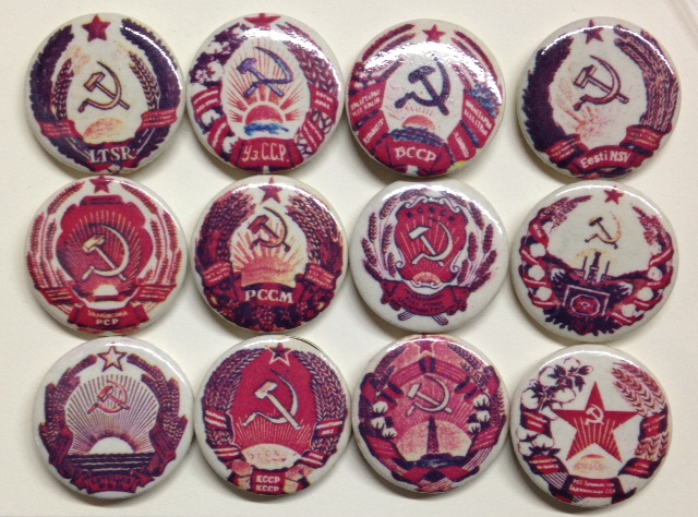 [Twelve different pins with emblems of various Soviet republics]