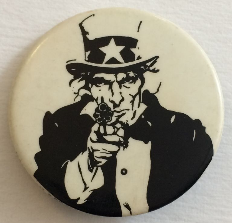 [Pinback button depicting Uncle Sam aiming a gun at the viewer]