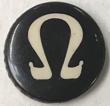 Pinback Button With The Omega Symbol For Resistance To The Vietnam War
