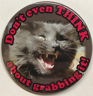 Don't even THINK about grabbing it! [pinback button depicting a snarling pussy cat]