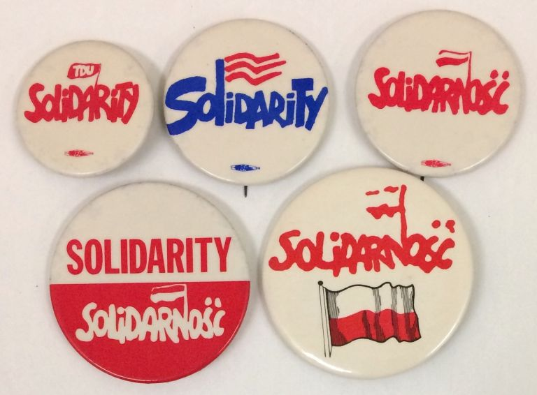 [Five different pins showing US labor solidarity with the Polish Solidarnosc movement]