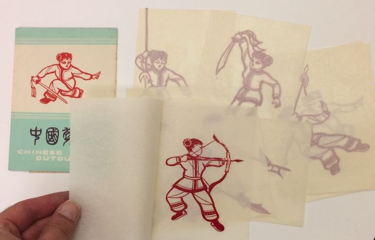 Zhongguo jianzhi / Chinese paper cutouts [Paper folder containing eight different handmade papercuts in red, depicting a militant young woman using various martial implements]