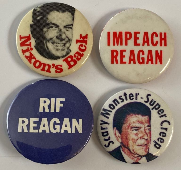 [Four different anti-Reagan pinback buttons]