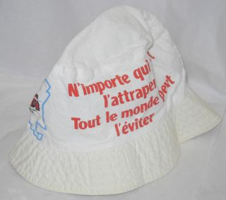 "Cloth hat imprinted with the slogan; ""N'Importe qui peut l'attraper, tout le monde peut l'eviter"" roughly translates as [Anyone can catch it, everyone can avoid it]"