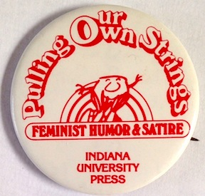 Pulling our own strings: feminist humor & satire [pinback button