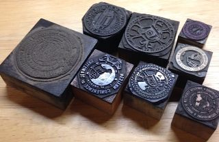Eight union seals mounted on wooden blocks for use in a print shop