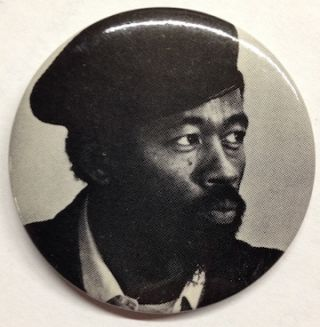 Pinback button with portrait of Eldrige Cleaver wearing a beret]. Eldridge Cleaver