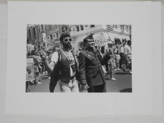 Seven glossy b&w photographs of gay pride events