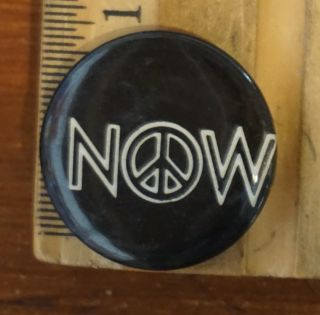 "Now [pinback button with peace sign in the ""o"""