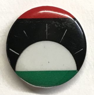 [Pinback button with a stylized flag of Biafra]