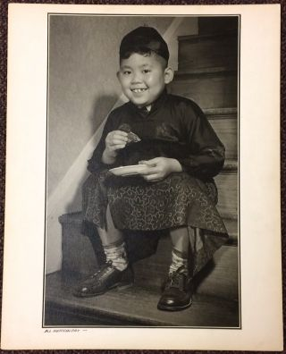 All American Boy [large photo print of a Chinese-American boy eating on the stairs]