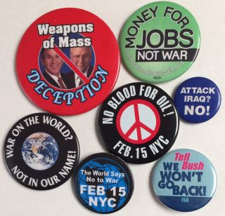 Seven different pins from the Feb. 15, 2003 march against war in New York City